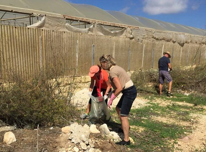 Volunteers help pick up litter in Gozo during their Inaugral Clean Up Event