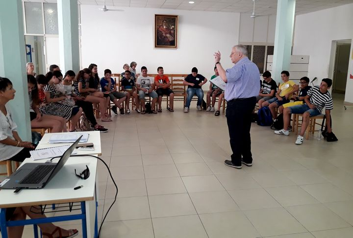 John Barnes from ESU Gozo speaks to children